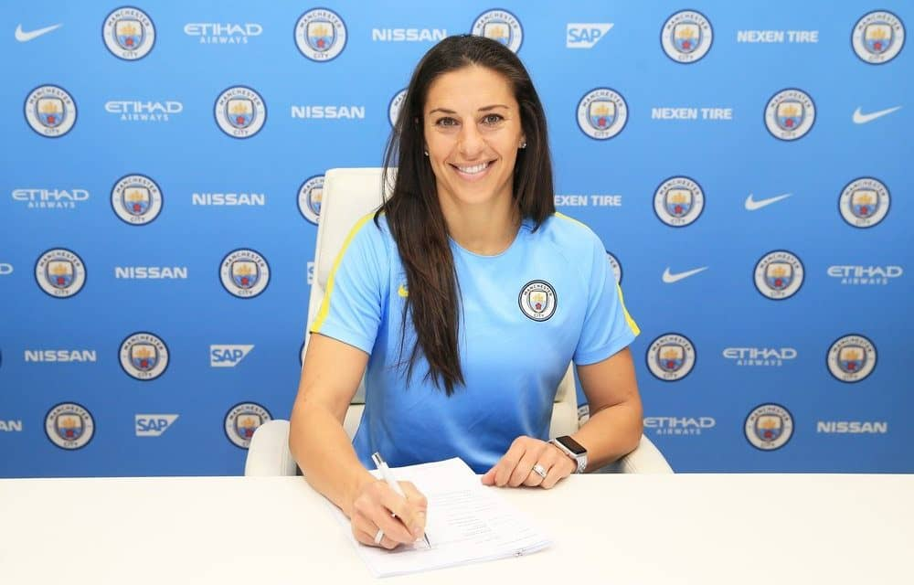SHE'S NOT KITTING: Carli Lloyd puts on the Manchester City kit