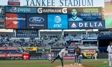FROM ONE PITCH TO ANOTHER: David Villa throws out the first ball at Yankee Stadium