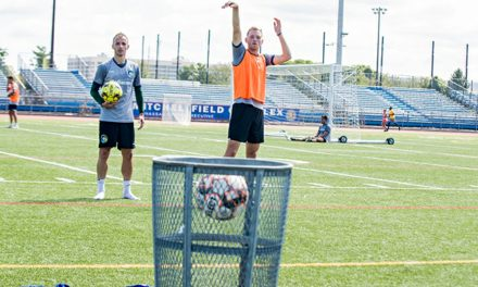 MANO A MANO: Soccer teammates Agolli, Lewis in a basketball duel