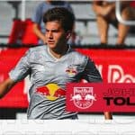 A SILVER LINING: Tolkin 25th Academy product signed by the Red Bulls